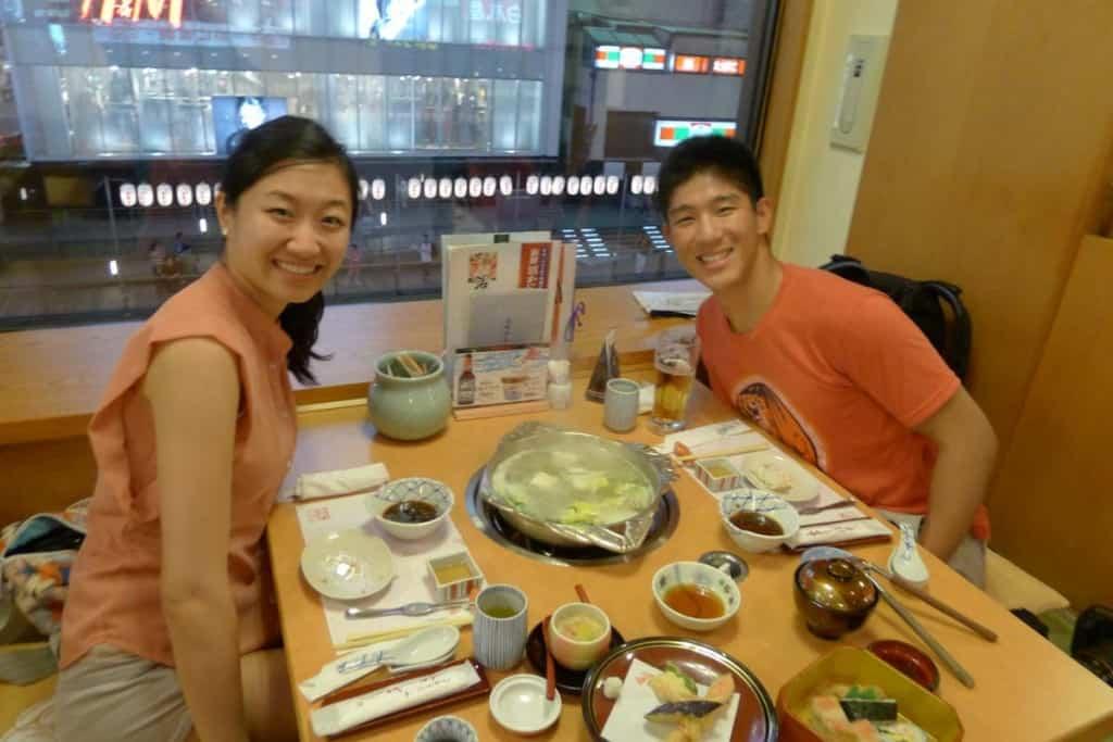 couple having dinner at kanidouraku dotombori-honten in osaka