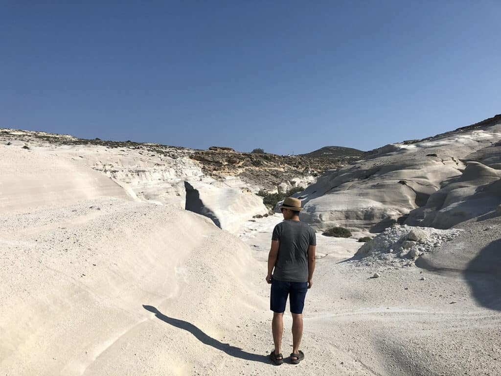 walking in the lunar landscape of sarakiniko beach in milos