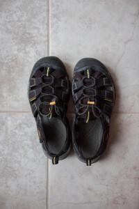 black keen newport h2 sandals on tile floor