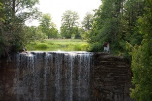 walking to near the edge of indian falls in owen sound