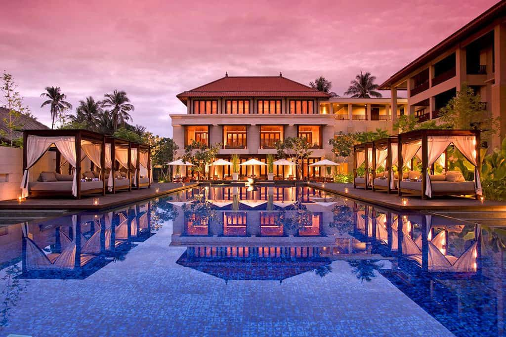 conrad bali review - a hilton resort pool sunset