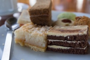 Assortment of Mandhoo afternoon tea sandwiches and cakes.