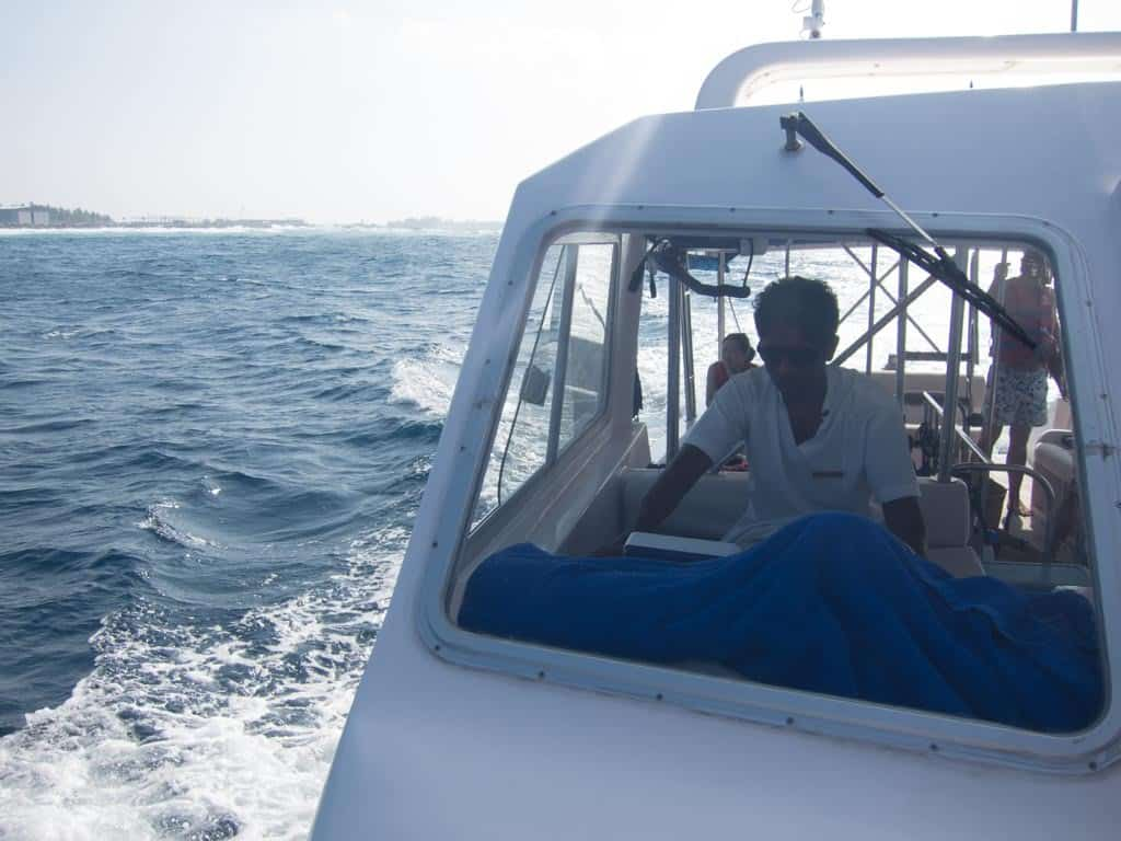 Snap of the captain and the speed boat we were on.