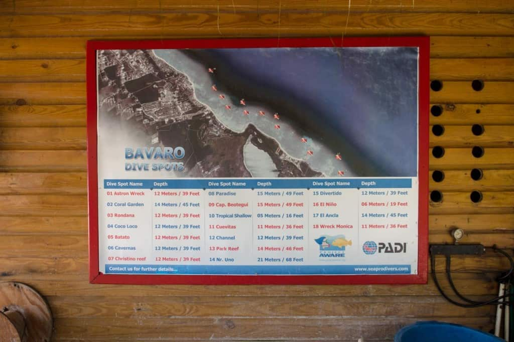 bavaro dive site map hanging on wooden wall of dive shop in punta cana dominican republic