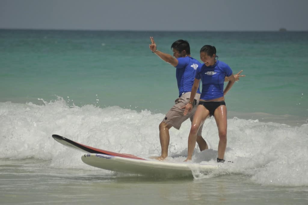 graceful surfing while showing peace signs