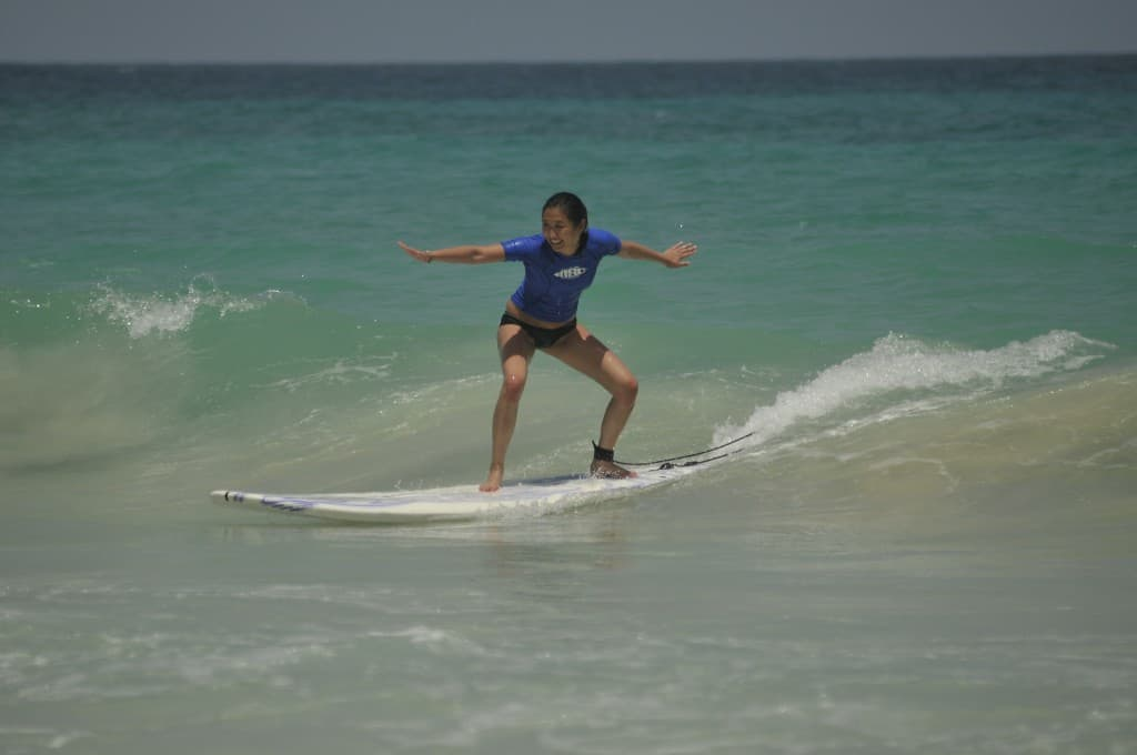 chantelle in fun surfing position with macao surf camp