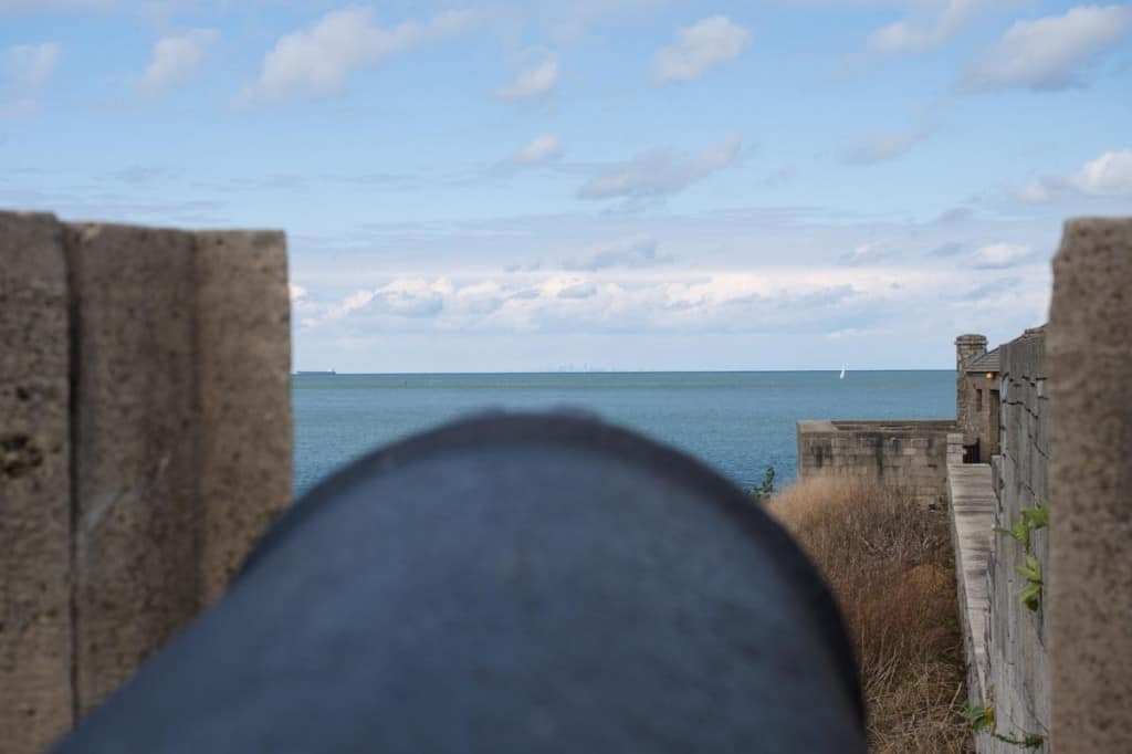 Cannons at the fort pointing straight out to the Toronto skyline behind.