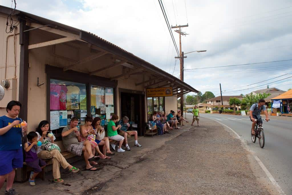 2 days in honolulu itinerary eating matsumoto shave ice outside the store in the north shore