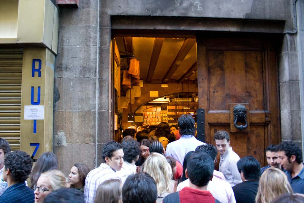 standing outside trying to get into the barcelona tapas bar can paixano
