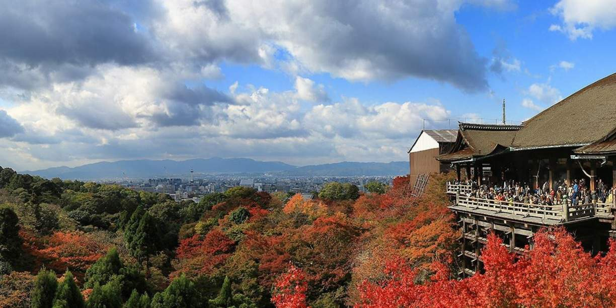 helping decide when is the best time to go to kyoto in japan with view of kiyomizudera with fall foliage