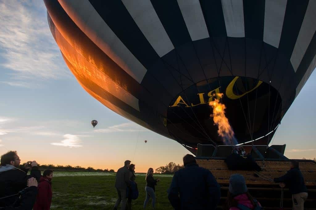 Filling the balloon with hot air.