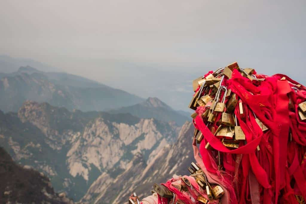 These red wraps and golden locks are found all over the mountain. They're a symbol of good luck with preceding climbers leaving special messages.