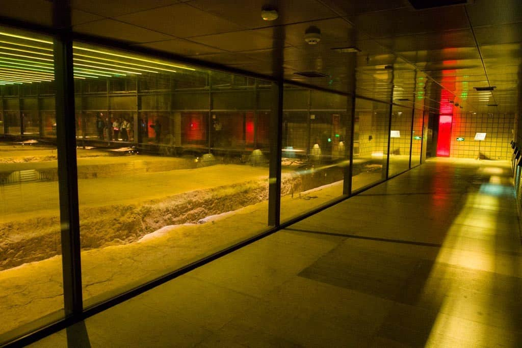 Being underground, the museum is not very well lit but once inside, you basically walk on top of glass floor and modern corridors built on top of the excavation site.