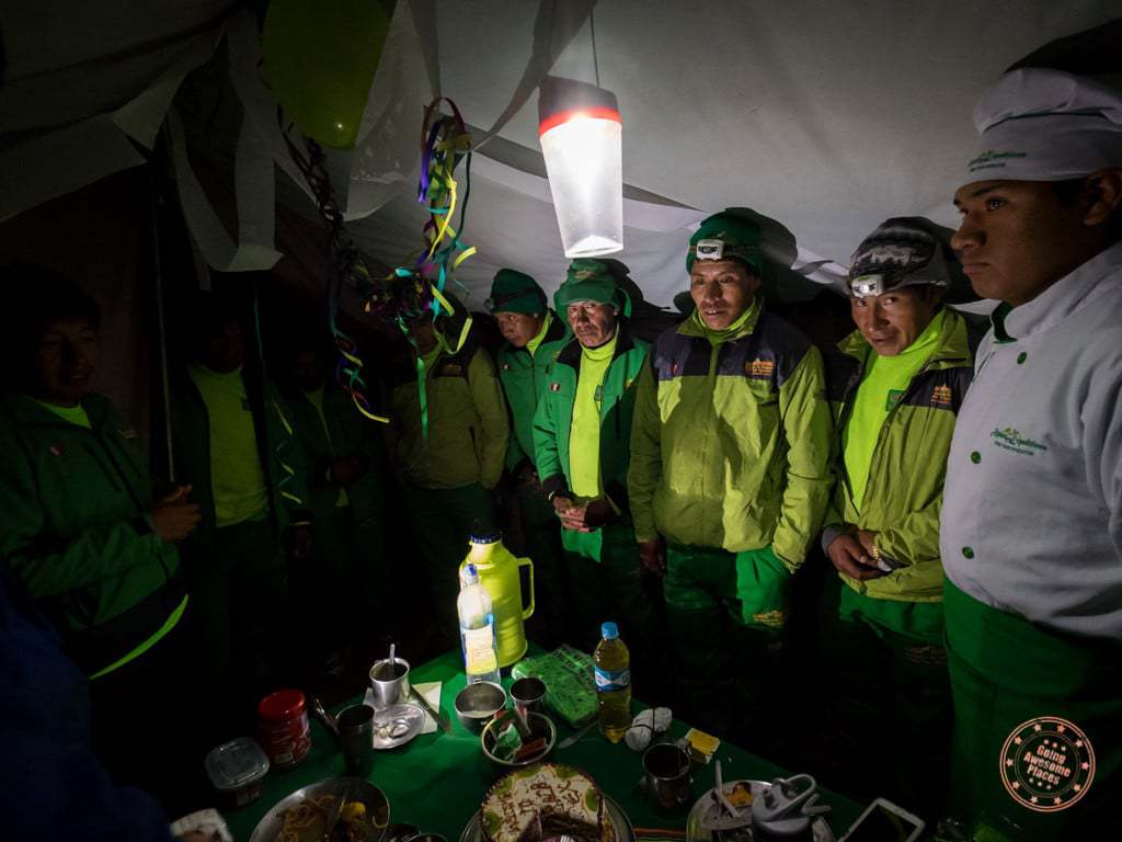 Our hardworking porters huddle into the tent to introduce themselves and say goodbye.