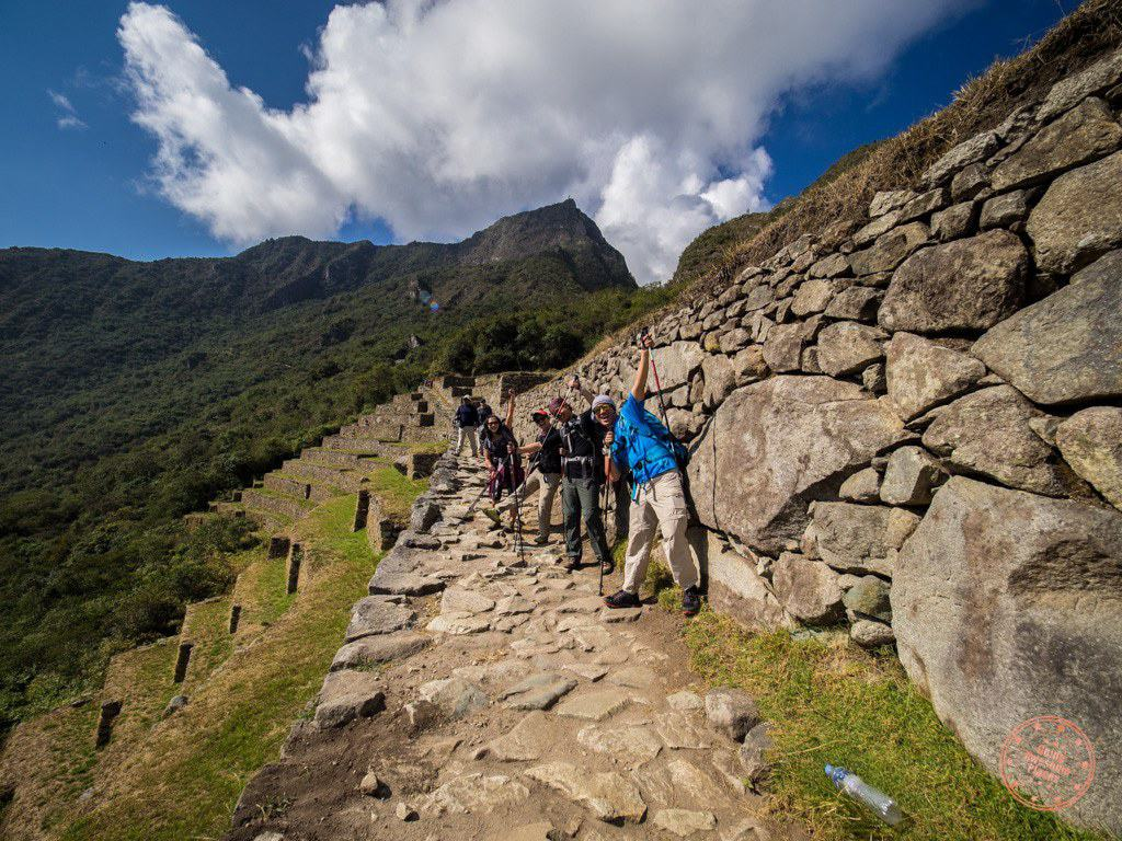 "At this point, the Inca Trail is more or less over and we ended up taking quite a bit of time taking group photos of the supposedly ""classic"" shot of Machu Picchu."