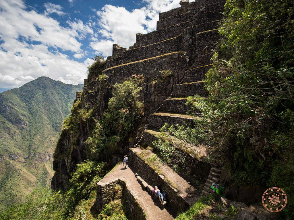 At the top of Huaynu Picchu, things become vertical real fast. To use the steps here, you pretty much have to monkey climb.