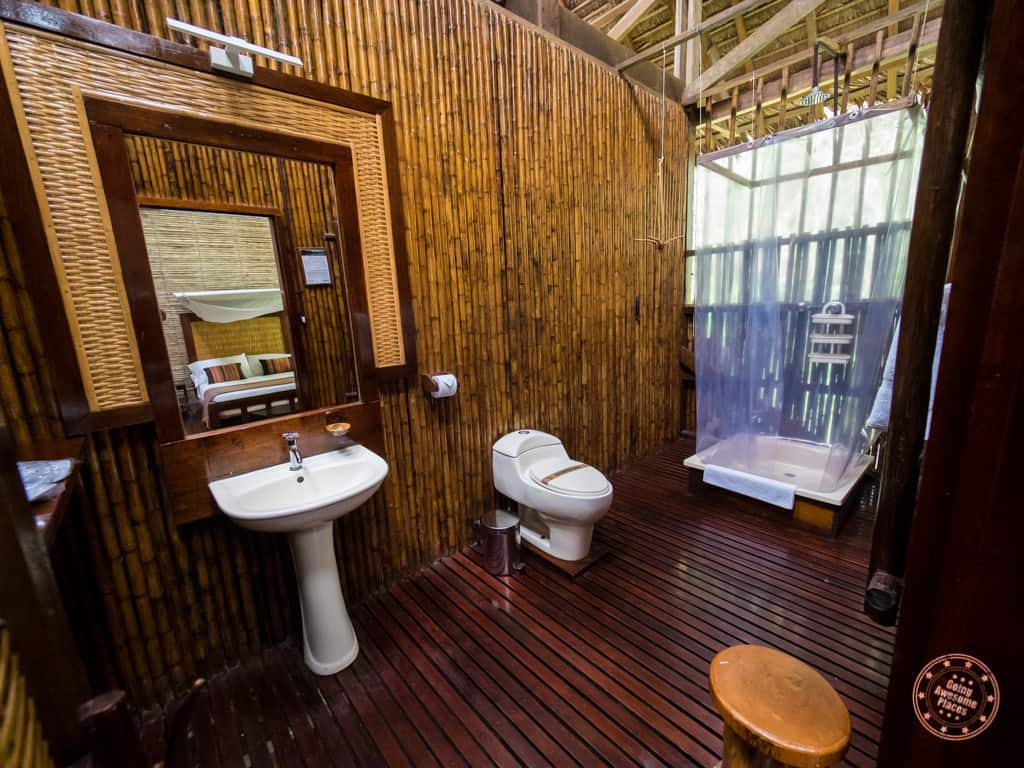 inside the classic room bathroom at the refugio amazonas in peru
