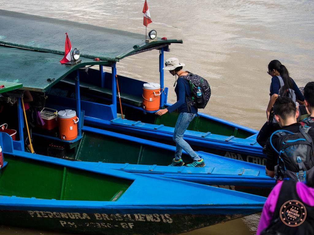Boarding boat on Tambopata River in Peru Amazon planning guide to Refugio Amazonas
