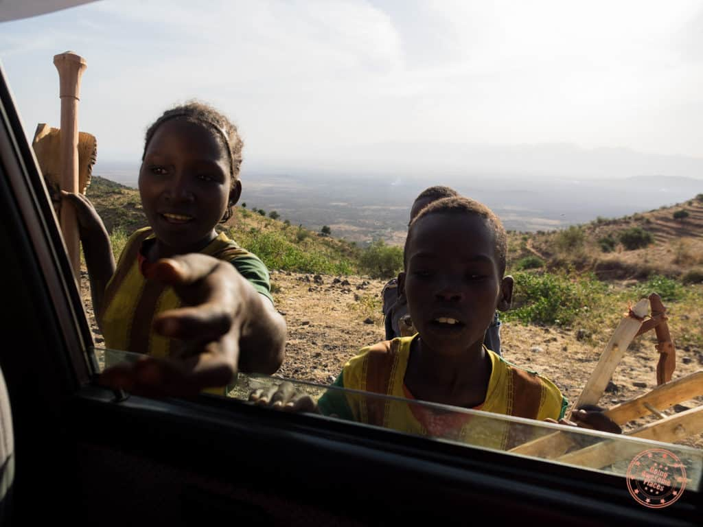 driving from arba minch to jink with kids through car window