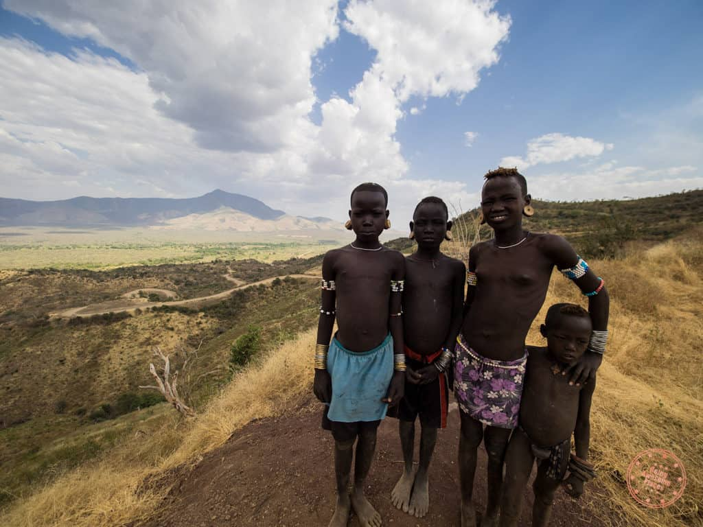 omo valley ethiopia tribe photography with kids begging for money
