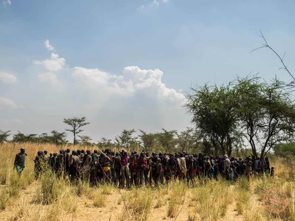 gathering of mursi tribe members for donga stick fighting tournament