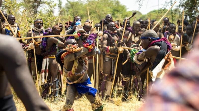 donga stick fighting tournament omo valley ethiopia mursi tribe featured