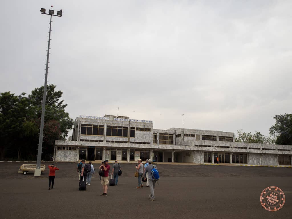 walking to the arba minch airport terminal during ethiopia omo valley itinerary