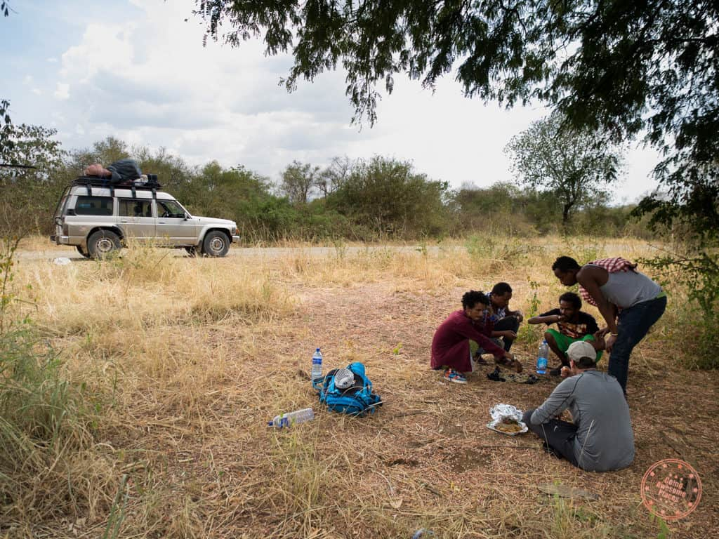 eating lunch on the side of the road with our guides towards omo valley 9 day itinerary