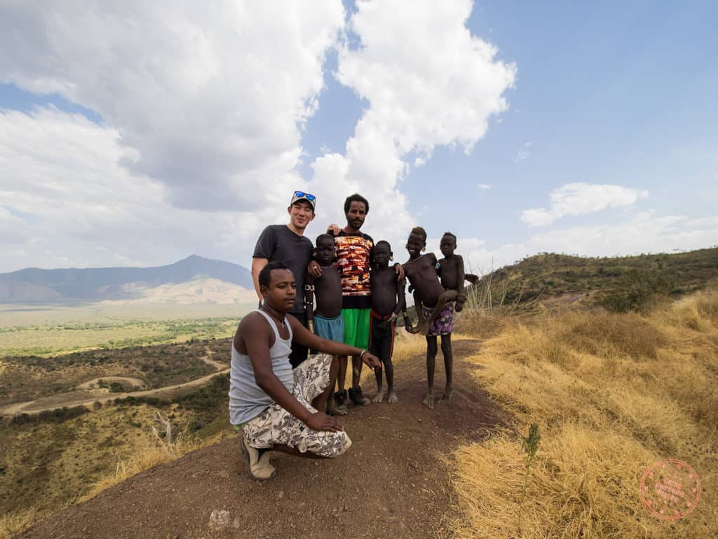 photos with omo valley tribe kids near the road as part of 9 day omo valley itinerary