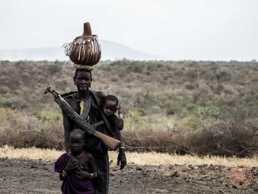 Mursi Woman with Gun and Children