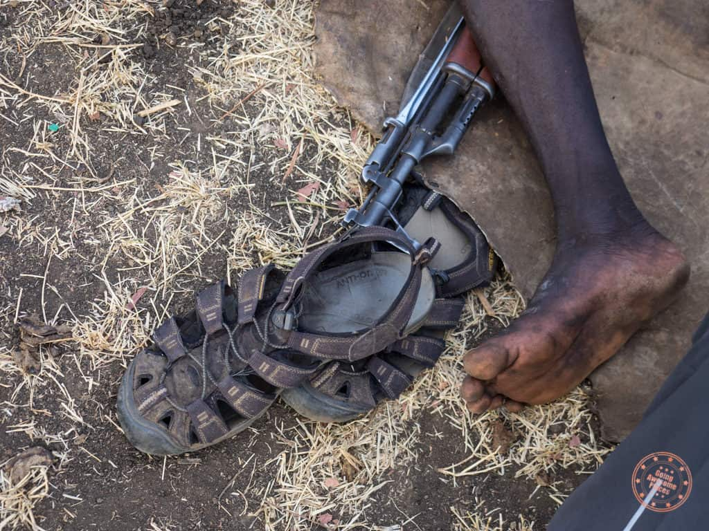 Mursi Tribe Keen Sandals and AK47