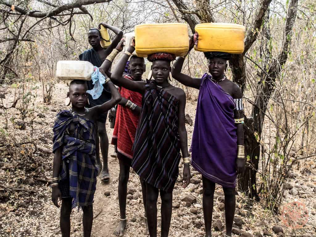 children bringing water back to the village in 9 day ethiopia itinerary
