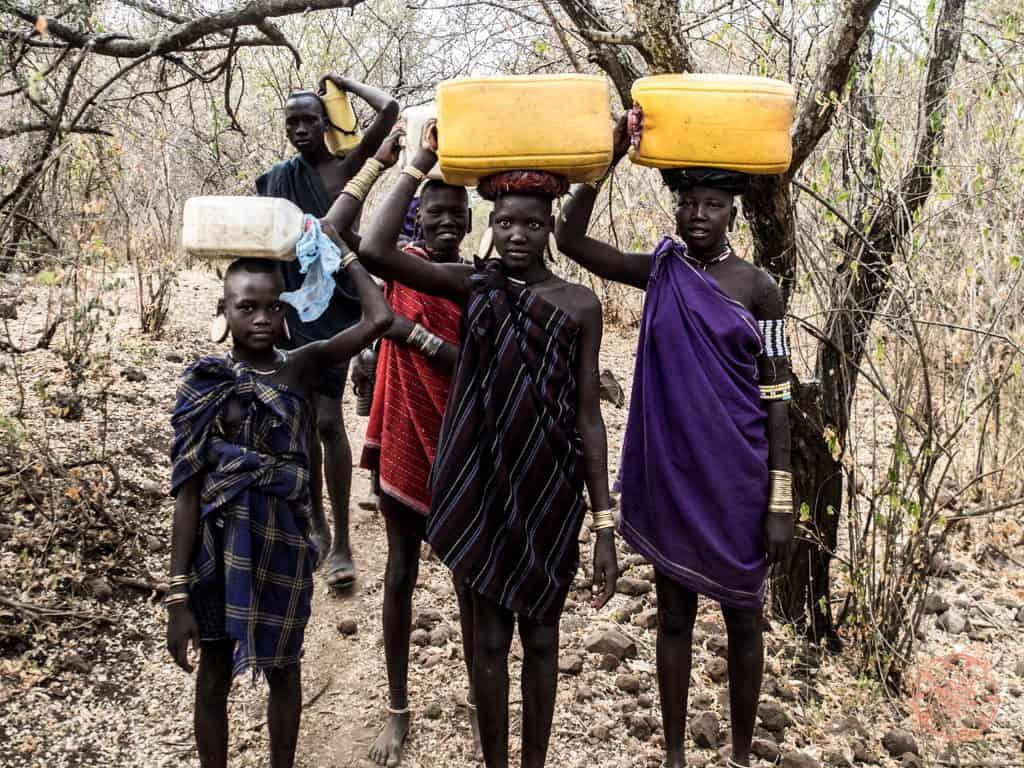 Children Bringing Water Back to the Village