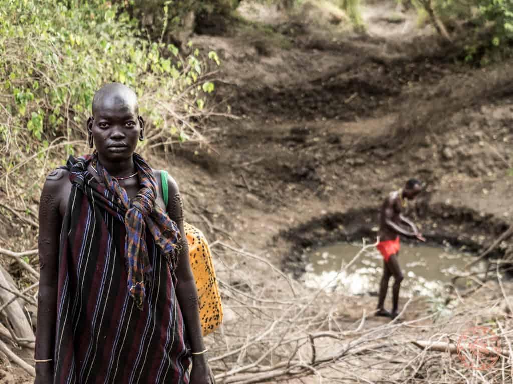Mursi Woman At Watering Hole