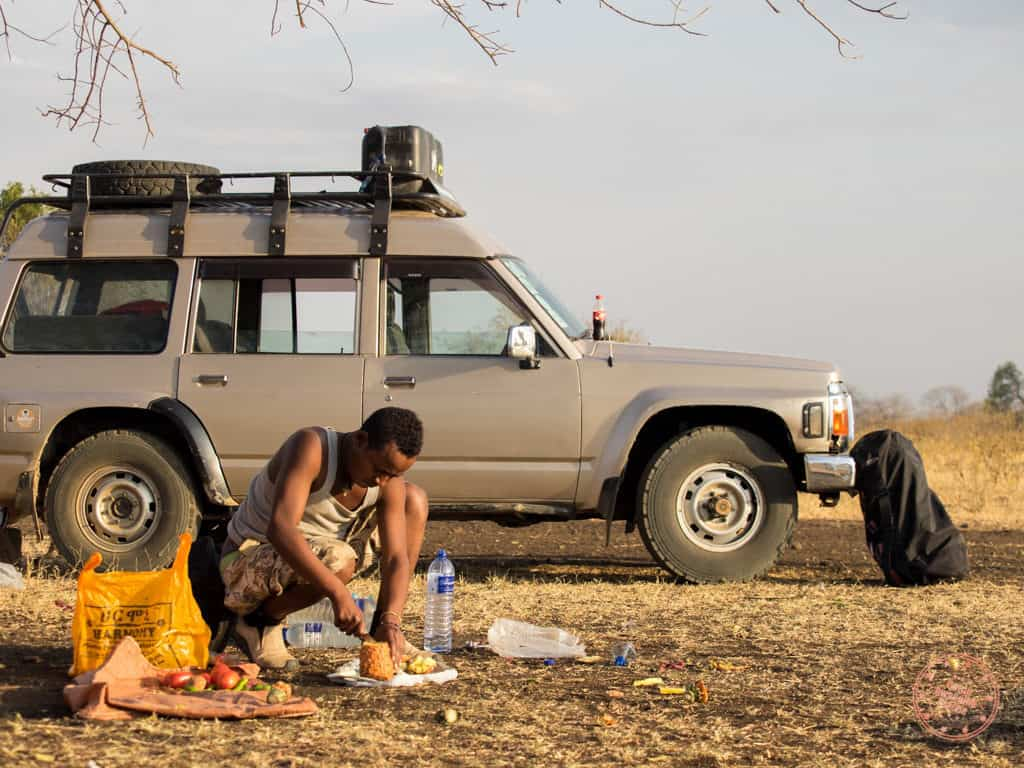 Lala from Jinka Preparing Food in ethiopia travel guide omo valley