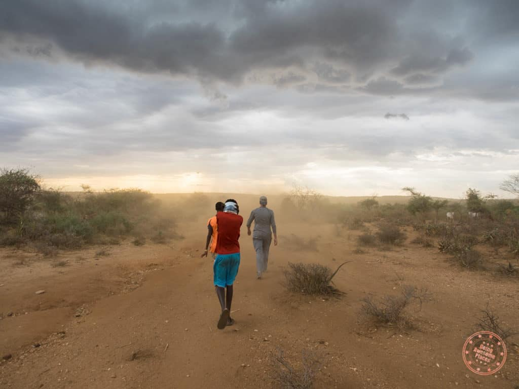 walking through sandstorm to get to hamar tribe family in omo valley ethiopia itinerary