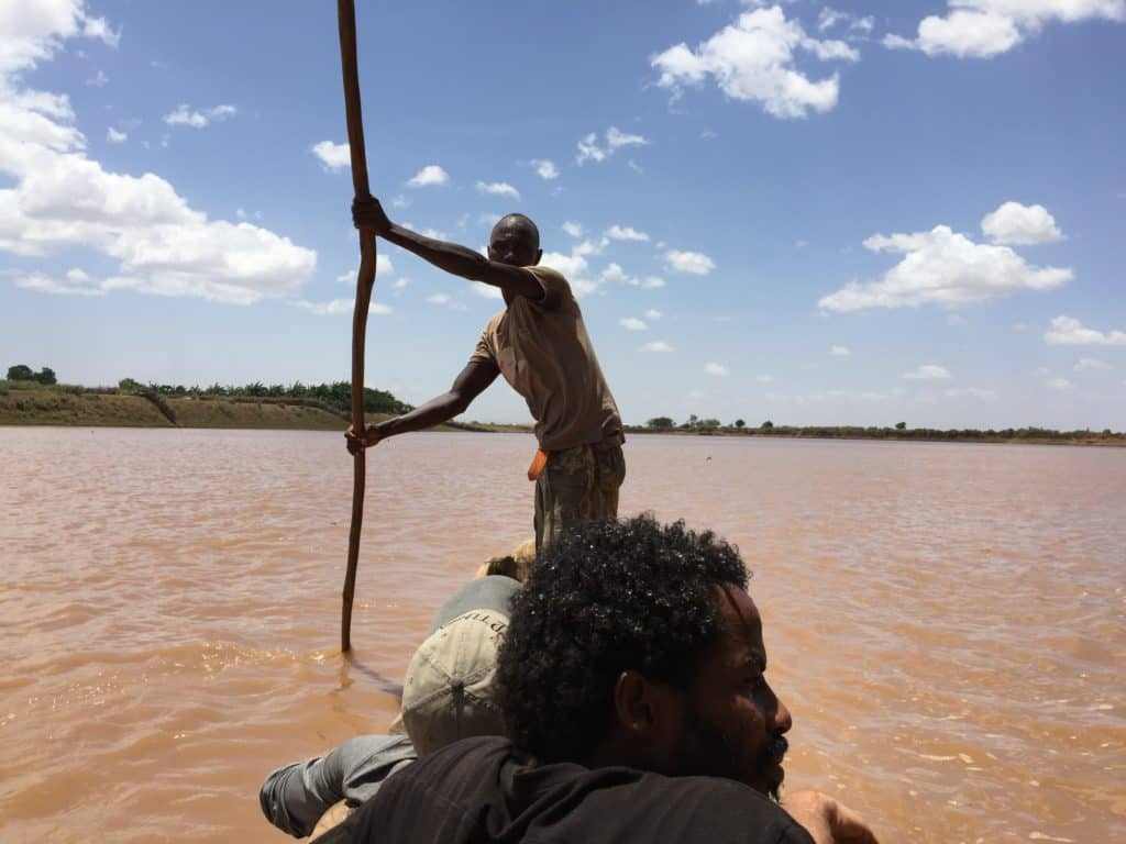 wooden canoe ride across the river to the dassenech tribe village omo valley