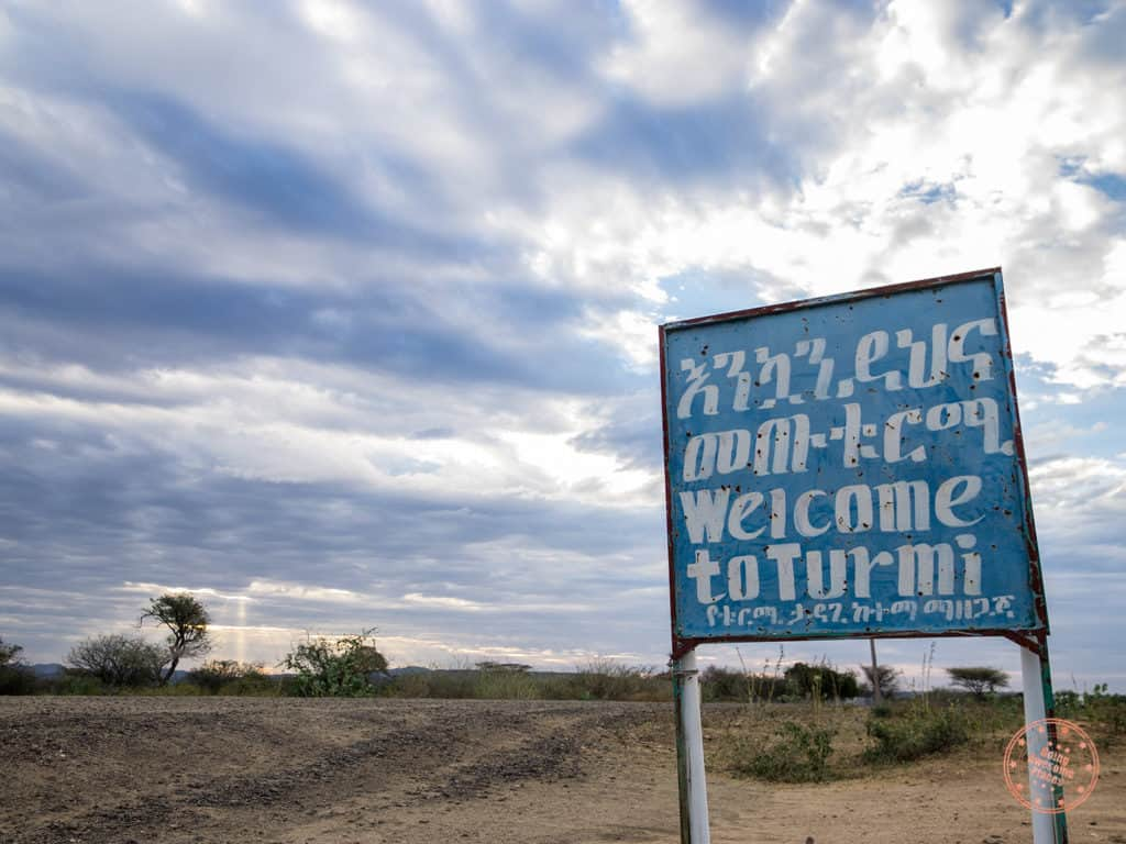 omo valley trip itinerary welcome to turmi sign