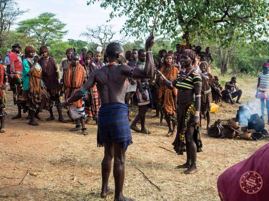 whipping women during bull jumping ceremony omo valley etthiopia