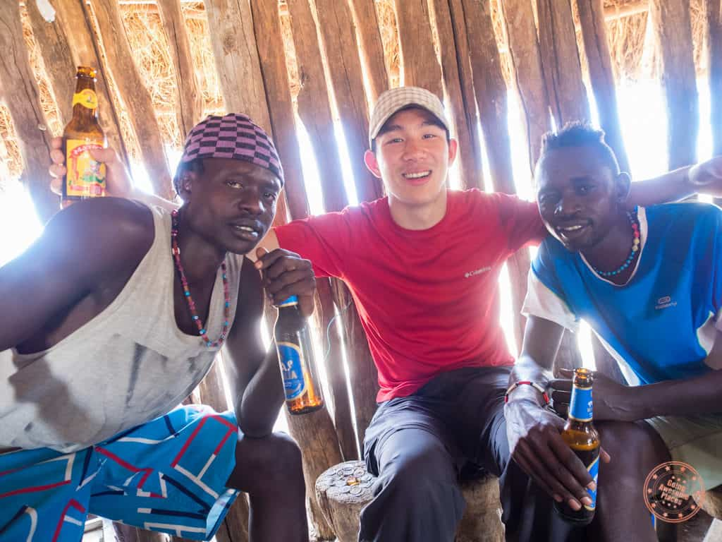 having a beer with karo tribe friends during ethiopia omo valley trip