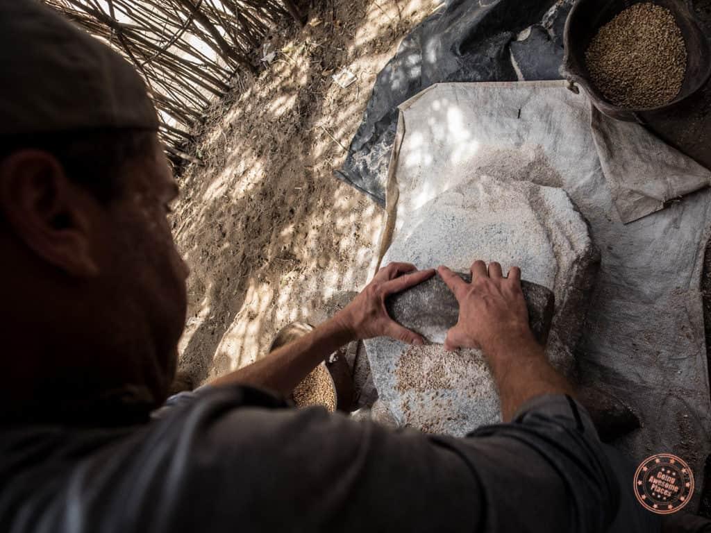 Grinding Sorghum in Karo Tribe