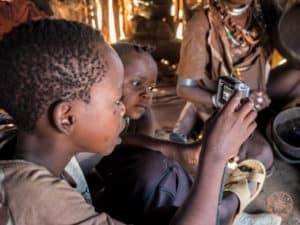 hamar tribe children playing with go pro in ethiopia omo valley