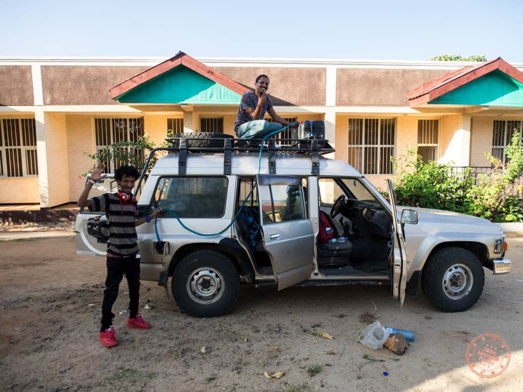filling up 4x4 suv in omo valley ethiopia
