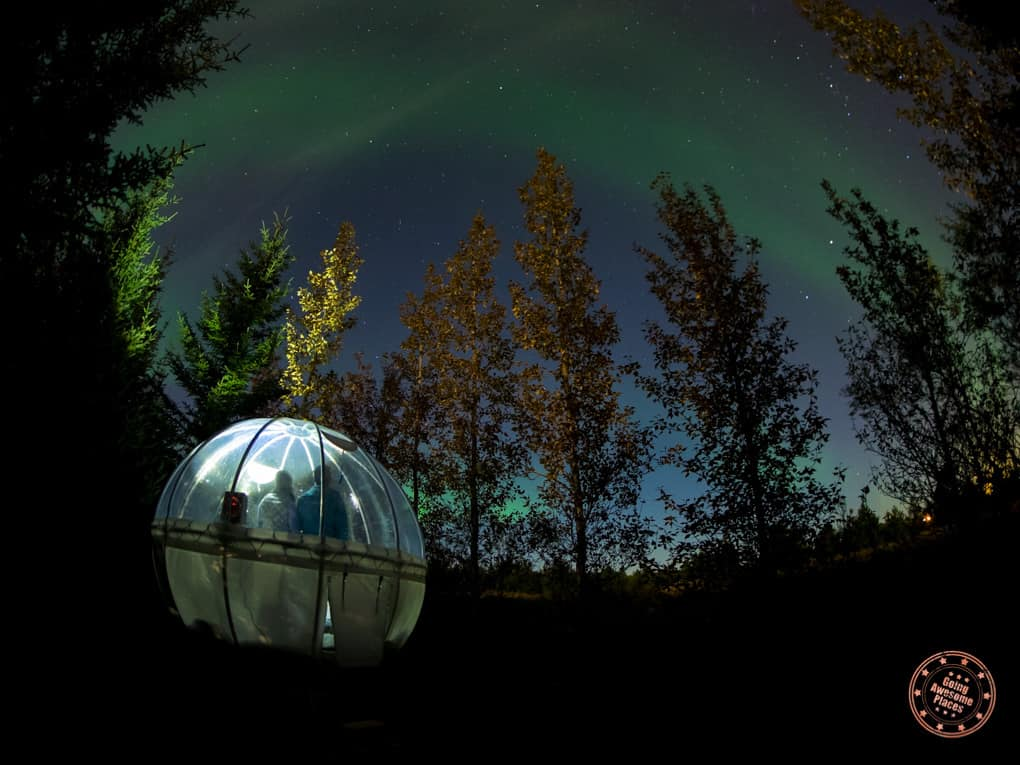 northern lights show from inside bubble hotel in iceland
