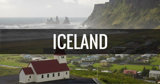 destination iceland with church town and coastline in the background