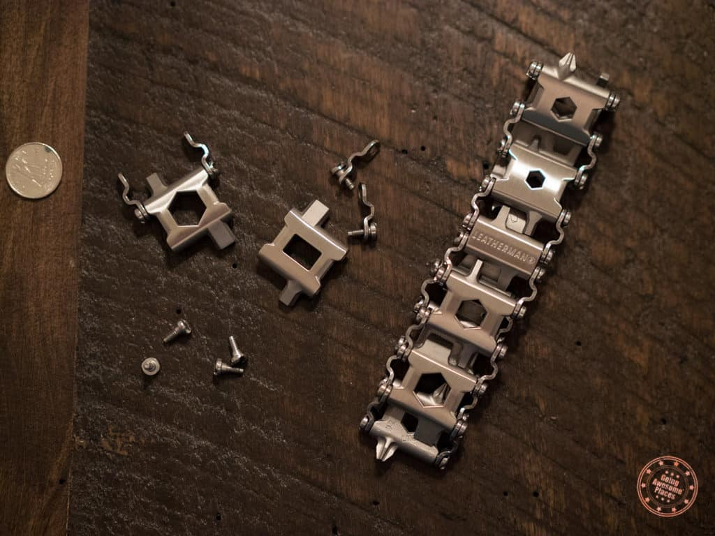 The Tread on a wooden table with removed tool links and their screws