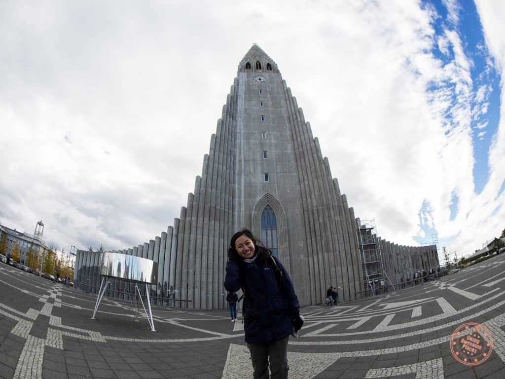 woman in front of hallgrímskirkja church in reykjavik iceland