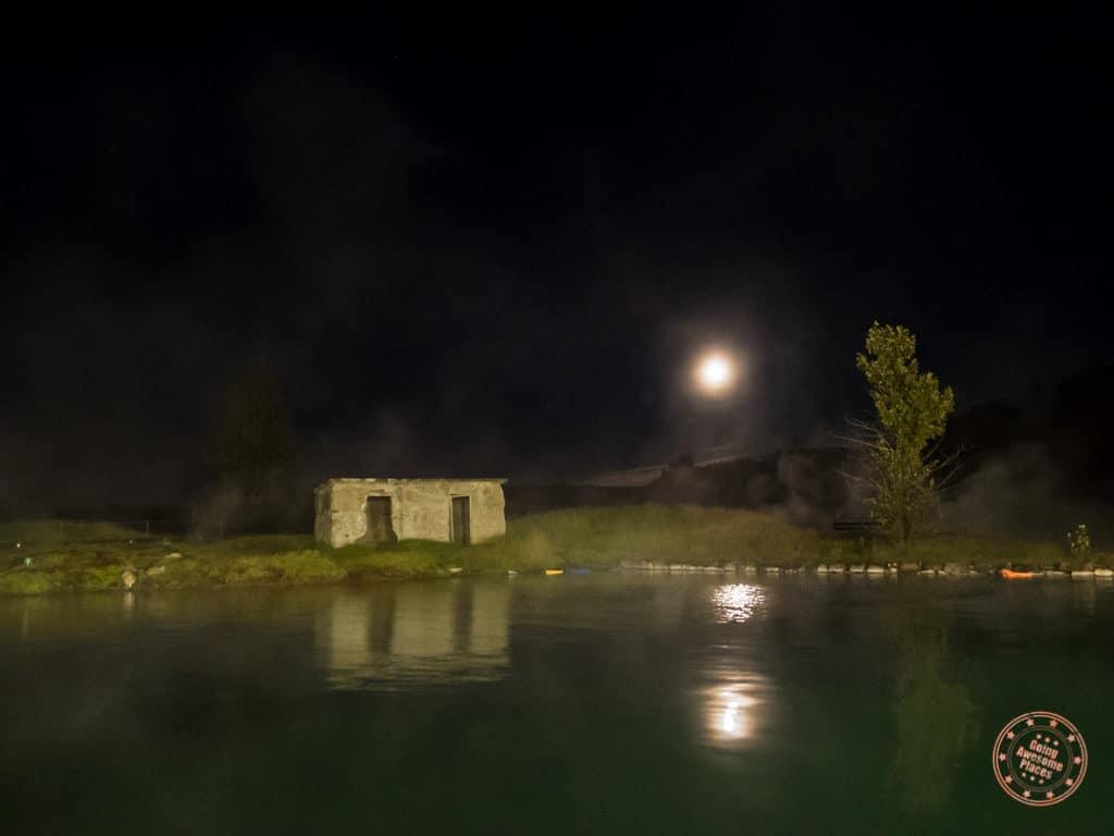 secret lagoon in fludir iceland at night