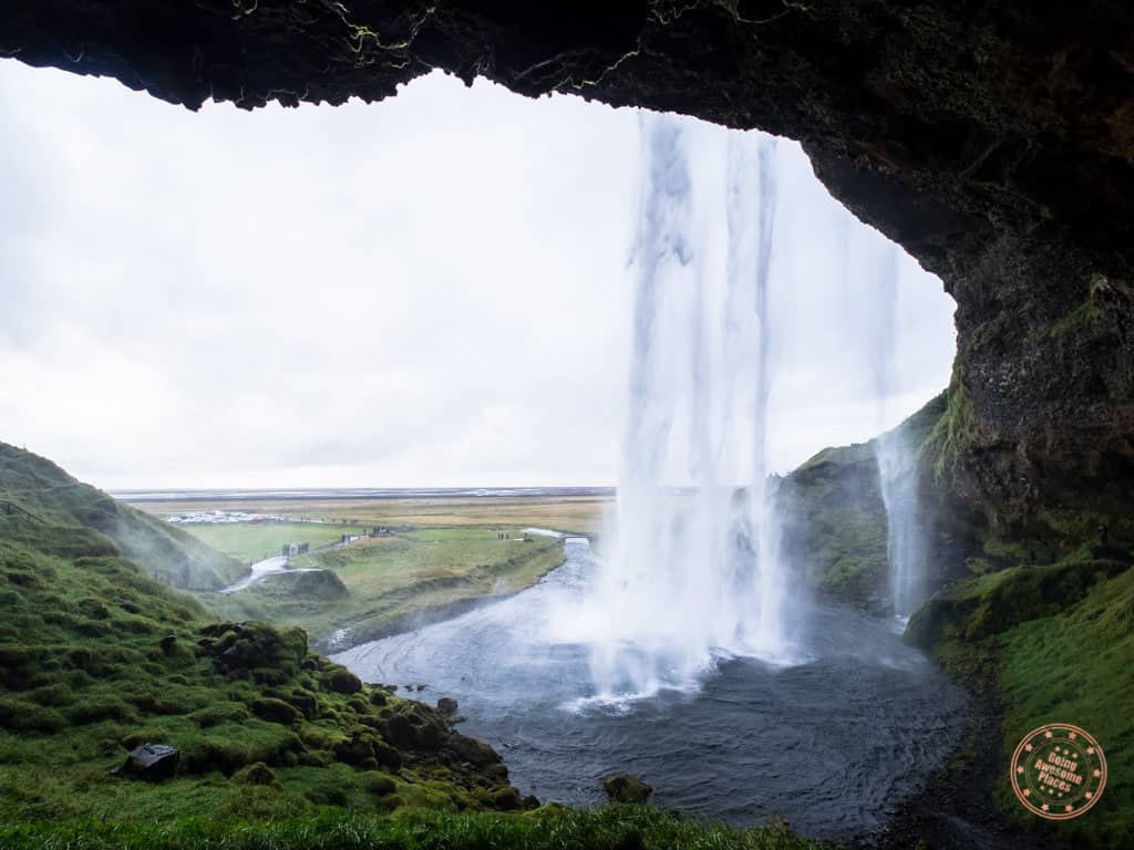 view of seljialandfoss waterfall from behind the curtain