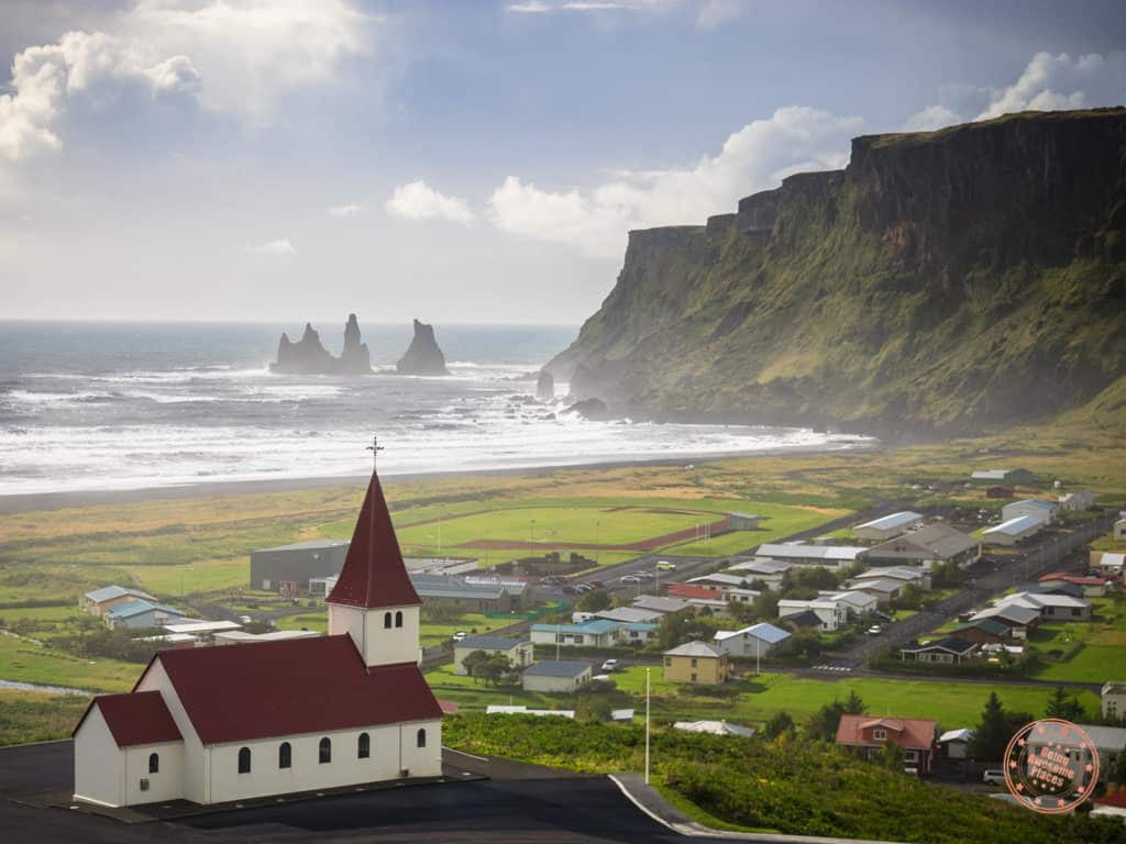 vik red church and view of reynisdrangar in the distance